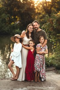 Outdoor family portrait shoot of mother, father and daughters.