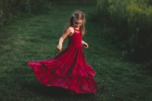 Family photo of daughter in red dress.