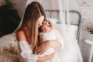 Photo of mom with newborn baby.