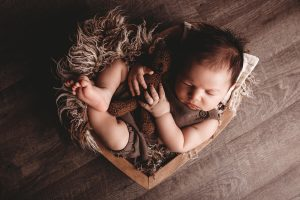 Photo of baby in wooden box.